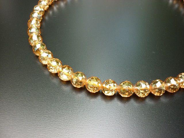 Křišťál broušená aqua aura zlatá 8 mm